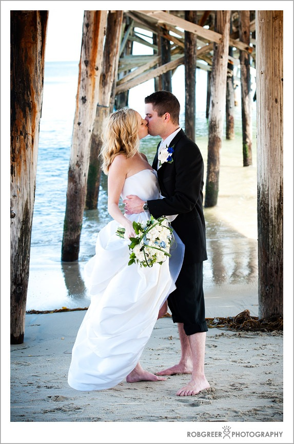 Kissing under the Pier at Paradise Cove